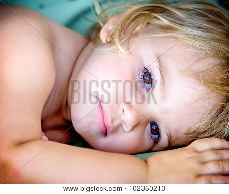 Portrait Of A Beautiful Two Year Old  Girl With Blonde Hair