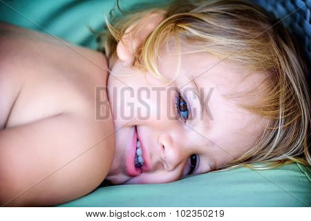 Portrait Of A Beautifull Two Year Old  Girl With Blonde Hair