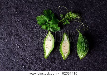 Balsam Pear On Wet Black Stone Plate Background
