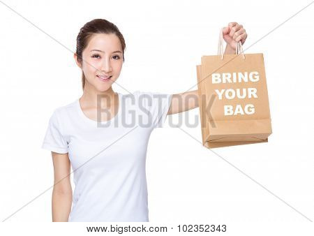 Woman carry with shopping bag and showing phrase of bring your bag