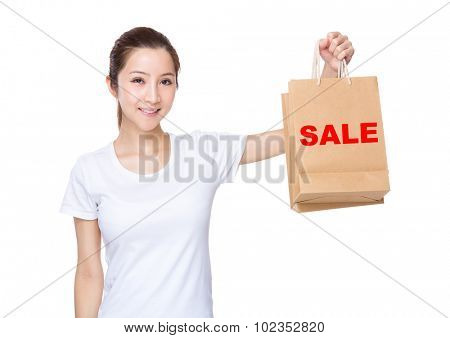 Woman carry with shopping bag and showing a word of sale