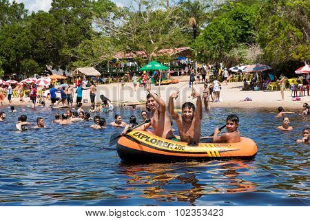 AMAZON, BRAZIL - CIRCA SEPTEMBER 2015: The Amazonians enjoying a hot and beautiful day on the beach in Amazon, Brazil