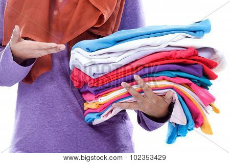 Hands Presenting Clean And Tidy Folded Clothes After Ironing