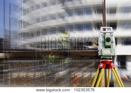 surveying measuring instrument, close-ups,  aimed at building site, zoom effect on background
