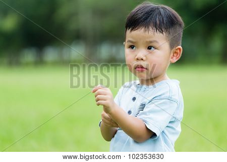 Asian Baby boy feeling itchy on hand