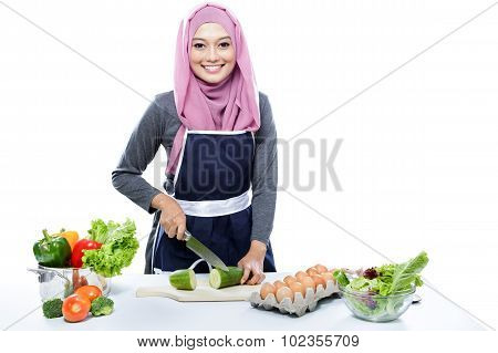 Young Housewife Preparing Making Food For Dinner