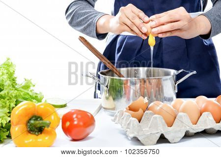 Hands Of Housewife Breaking An Egg Making A Meal