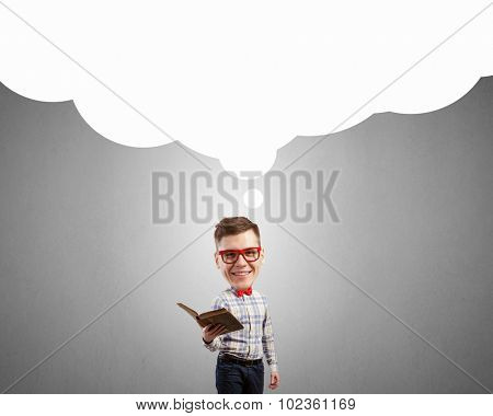 Young funny big headed man in glasses with book in hands
