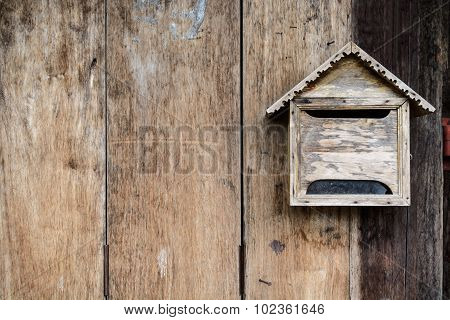 Old Wooden Mailbox With Old Vintage Wooden Background