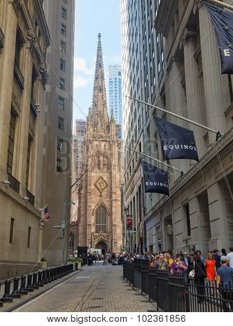 NEW YORK,USA - AUGUST 13,2015 : Wall Street and Trinity Church at the Financial District in New York City