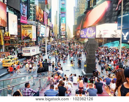 NEW YORK,USA - AUGUST 14,2015 : Tourists and colorful neon billboards at Times Square in New York City