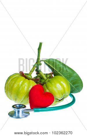 Garcinia Cambogia, Red Heart-shaped And Stethoscope On White Background.