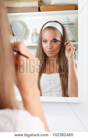 Beauty Woman Fixing Her Eyebrow