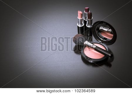 Makeup products on dark background