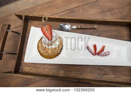 fresh strawberry Choux Cream on wooden tray.