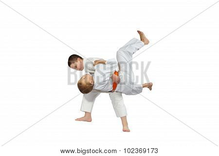 High throw judo performs  athlete with yellow belt