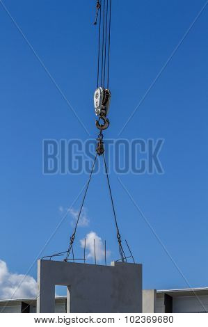 Crane lifting concrete panels