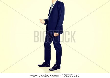 Side view of a men in smart clothes.