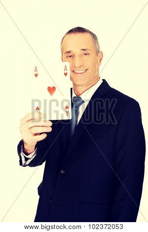 Smart mature business man with red ace card.