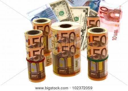currency of different denominations on a white background