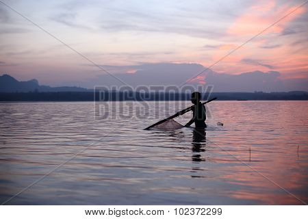 River and Silhouette Fisherman