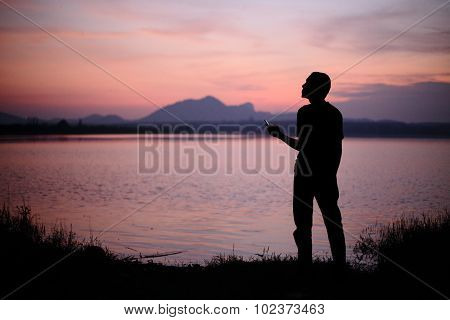 River and Silhouette Man