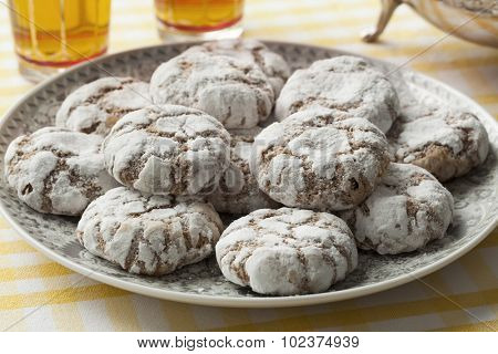Dish with traditional Moroccan Ghribas cookies with tea
