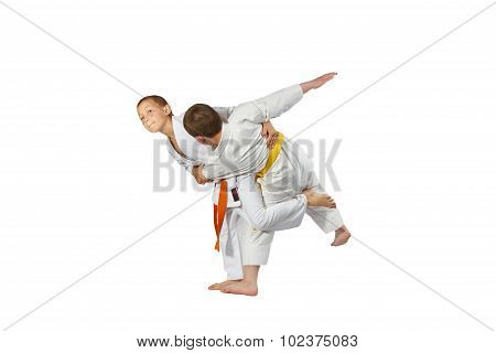 Boys in judogi are doing judo throws