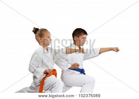Children are beating punch hand in rack of karate