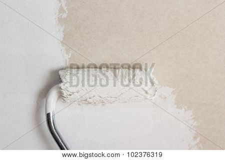 Paint roller on the wall