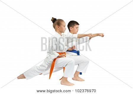 The Blow gyaku-tsuki are beating sportsmens in the racks karate
