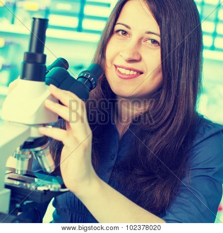 laboratory assistant at the microscope