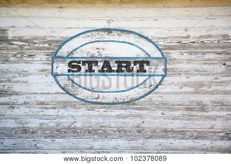 Start sign on weathered shed side