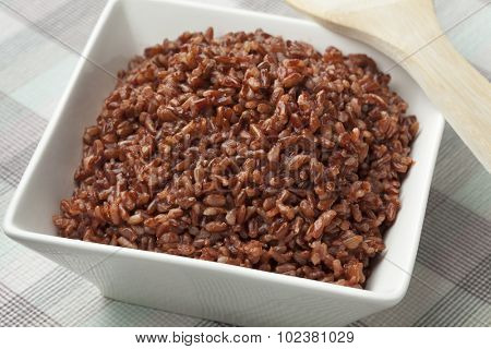 Cooked red rice in a bowl