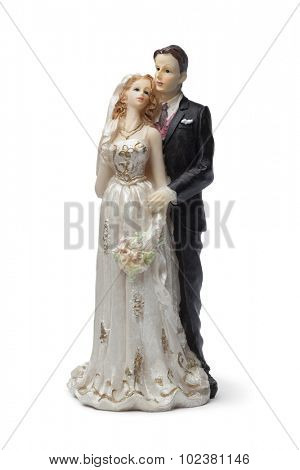 Old bride and groom cake topper on white background