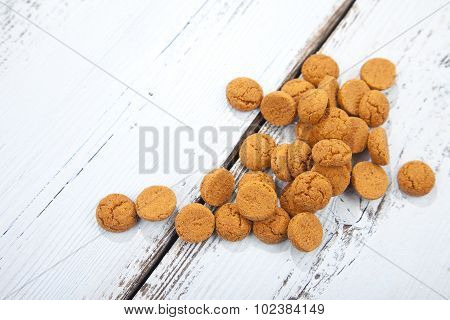 Pile Of Dutch Candy Pepernoot On White Wooden Background