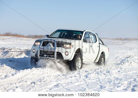 Khabarovsk, Russia - January 31, 2015: Mitsubishi L200 During Off Road Winter Sprint Race