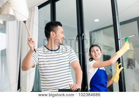 Indonesian couple cleaning their home