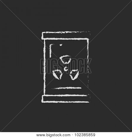 Barrel with ionizing radiation sign hand drawn in chalk on a blackboard vector white icon isolated on a black background.