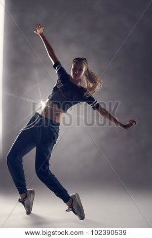 Female Hip Hop Dancer In Tiptoe Position
