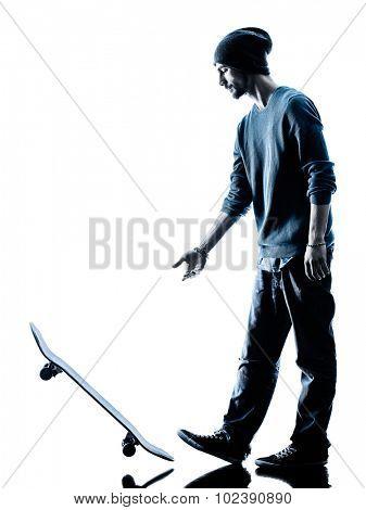 one caucasian man skateboarder skateboarding  in silhouette isolated on white background
