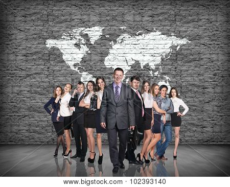 Business people stand on the big map background