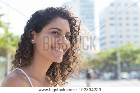 Laughing Latin Woman Outside In The City