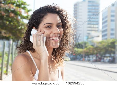 Latin Woman In The City Flirting At Phone