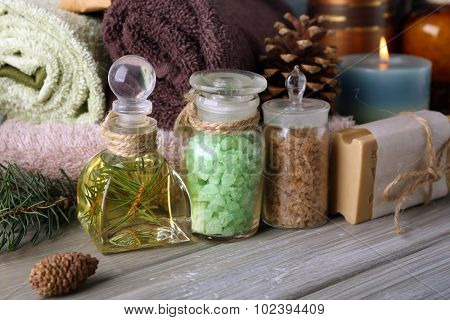 Spa treatments with pine extract on wooden background