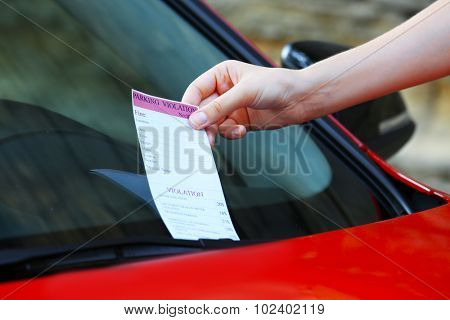 Parking violation ticket on car windscreen