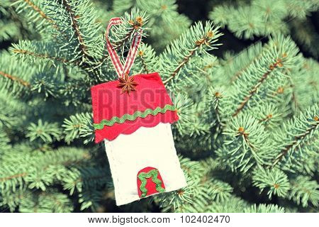 Christmas toy on fir tree branch, outdoors