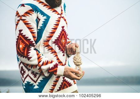 Man hands holding rope knot Travel Lifestyle survival concept