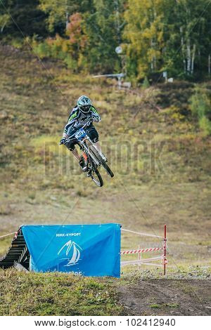 racer on the mountain Biking jumps from a springboard