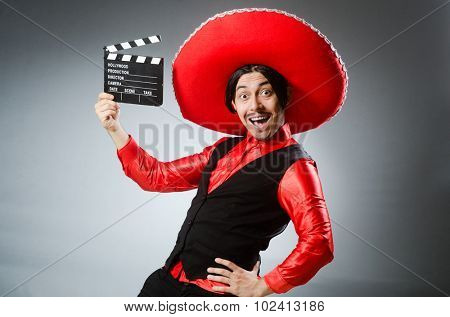 Mexican with movie board in funny concept